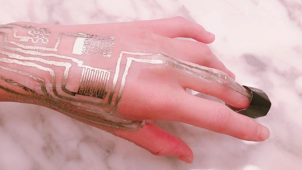 A hand with a gold sensor melded to it
