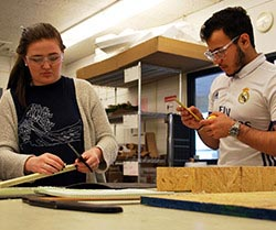 Students use materials such as paper, wood and cardboard to create prototypes of their EDSGN 100 projects.