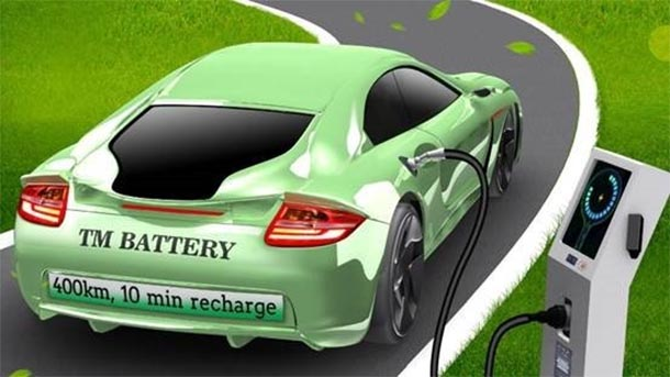 illustration of green modern car on a road attached by a plug to a charging station